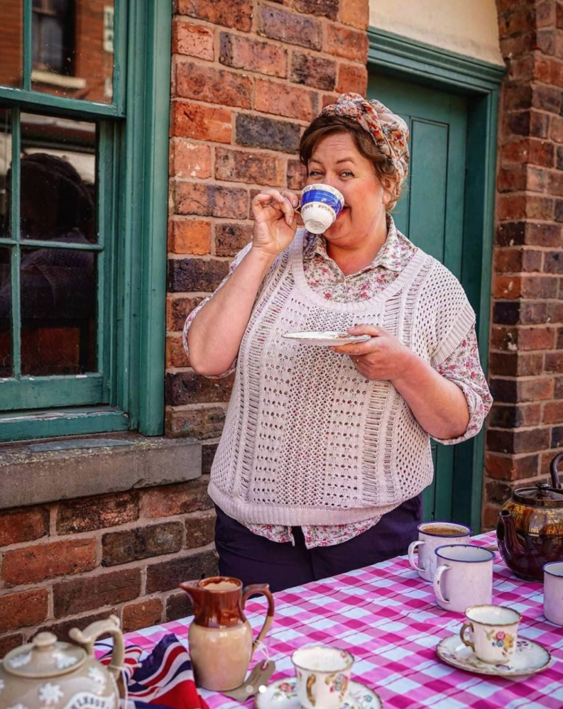 A character at black country living museum drinking tea