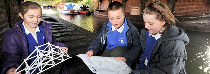 Children working alongside a canal at black country living museum